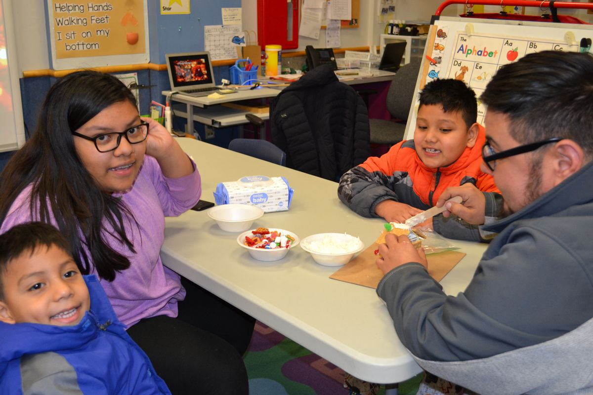 Sheboygan Area School District families information. Photo of a family at the Early Learning Center.