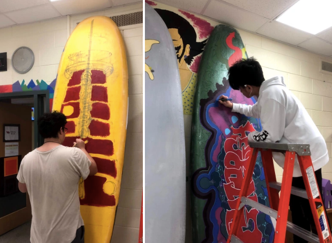 students painting surfboards